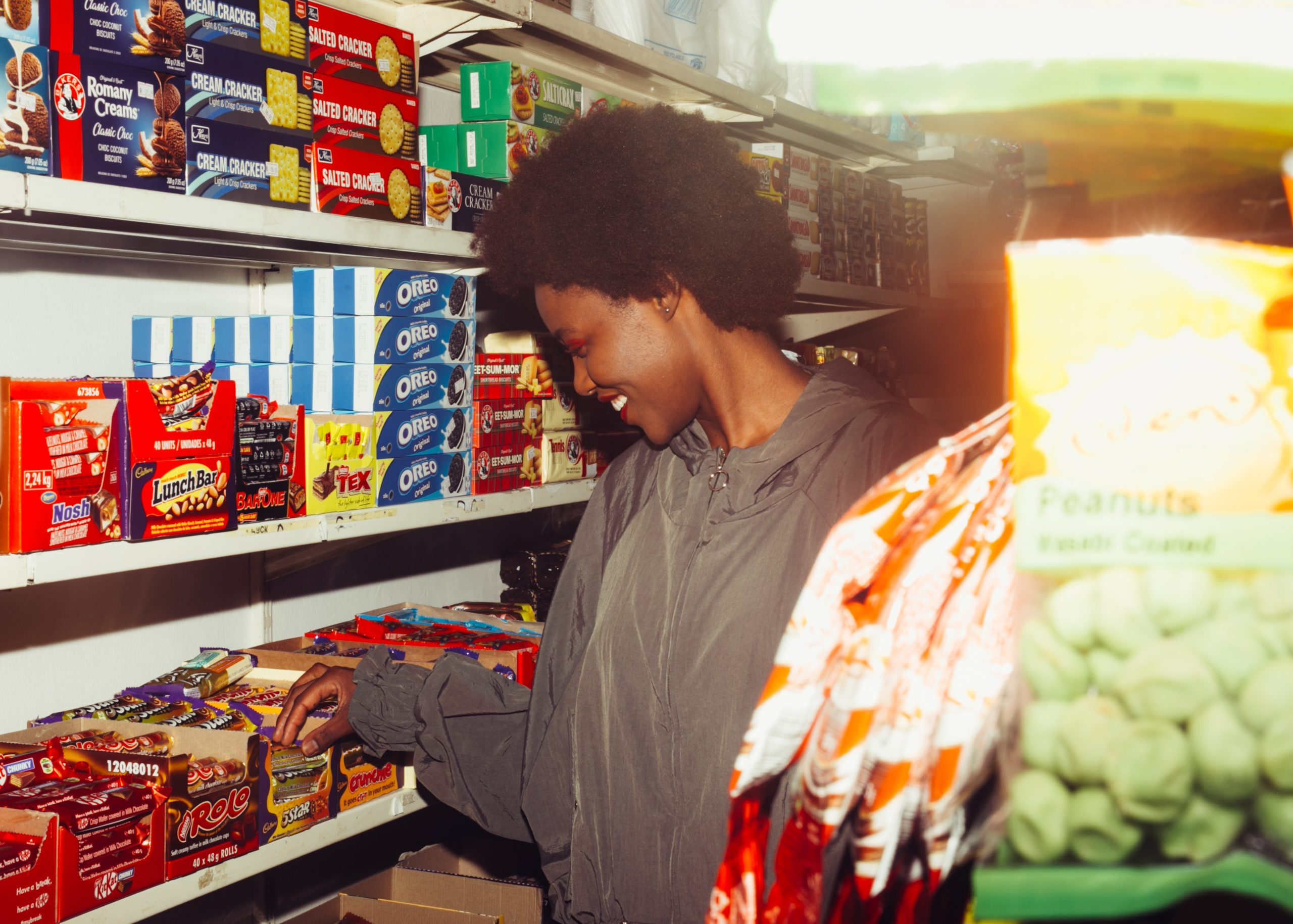 Woman buying British sweets in a store