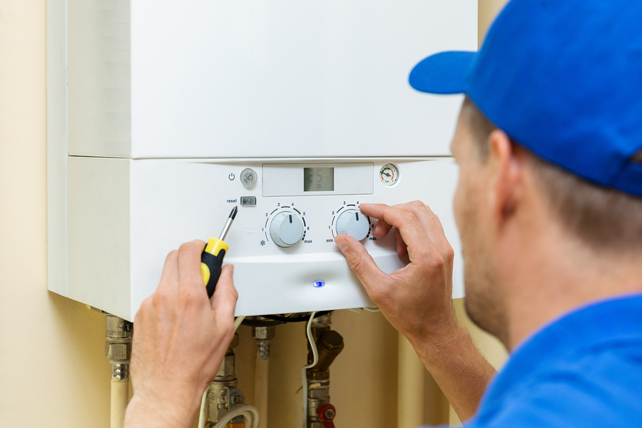 Hot water plumber in Canberra setting up a gas water heater at home