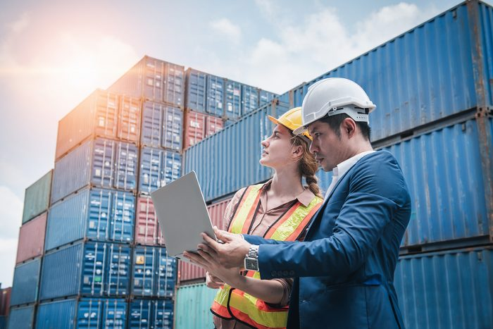 Freight forwarding workers doing an inspection